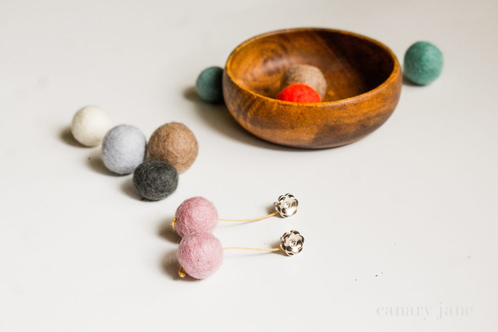 Today I'm going to share this super easy felt ball earring DIY. This tutorial is perfect for a simple craft or craft night as there are only a few supplies and it takes minutes. Here you go!